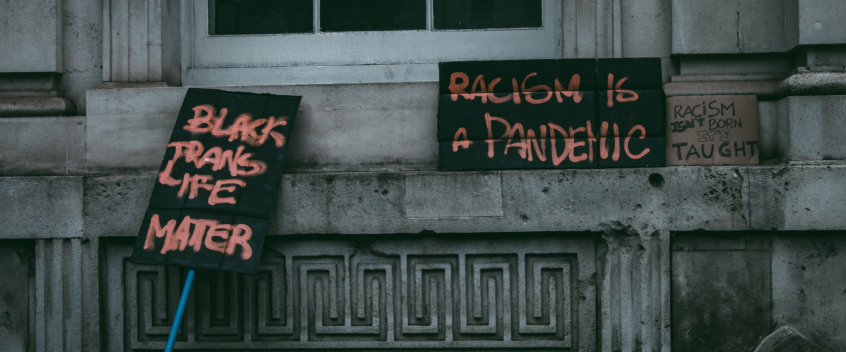 protest signage Photo by daniel james on Unsplash