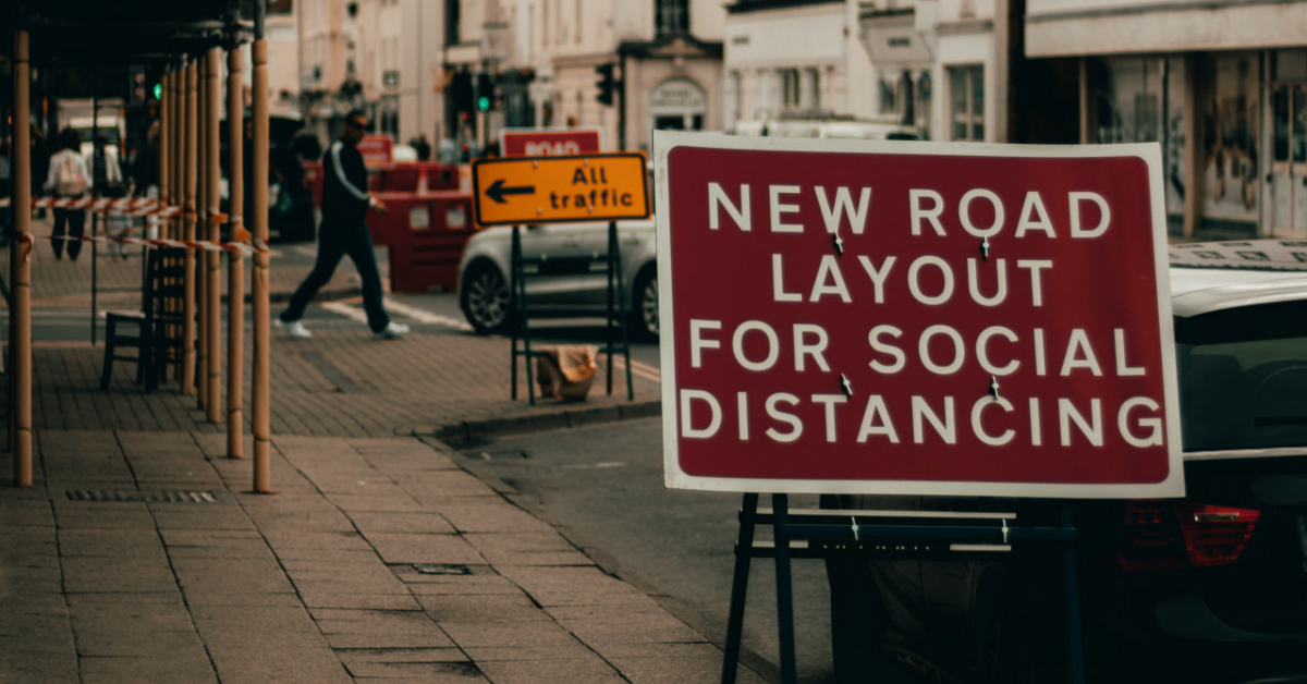 Road sign on Social Distancing. Photo by Alex Motoc on Unsplash