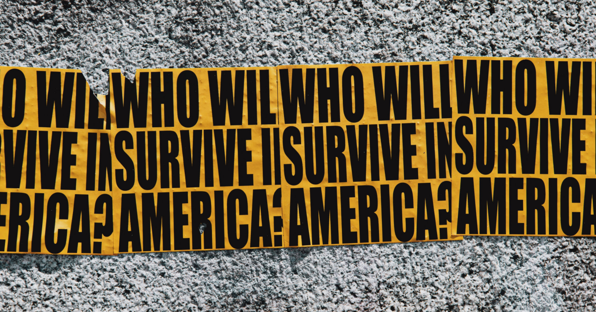 "posters on a wall reading ""Who will survive in America?"" Photo by LOGAN WEAVER on Unsplash."