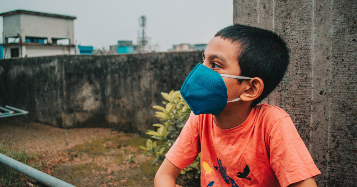 A young boy with a mask. Photo by Md. Shazzadul Alam on Unsplash