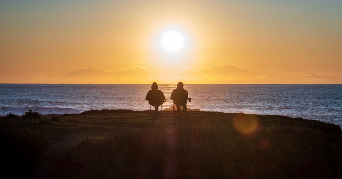 A couple watching the sunset. Photo by Anukrati Omar on Unsplash