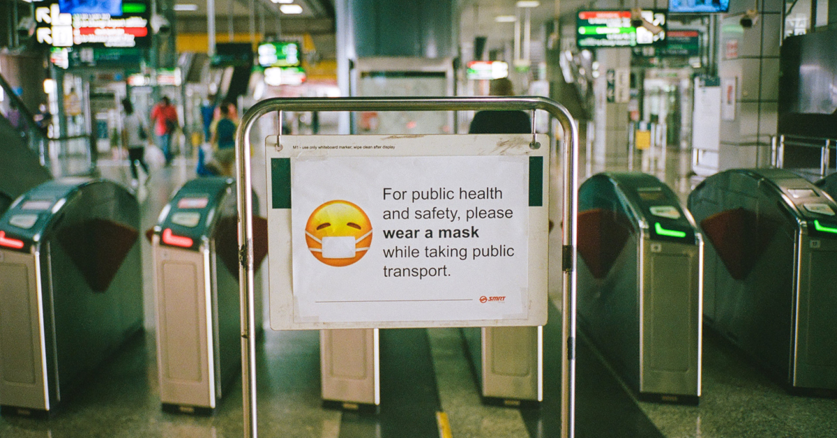 Sign asking mass transit riders to wear a face mask. Photo by Shawn Ang on Unsplash.