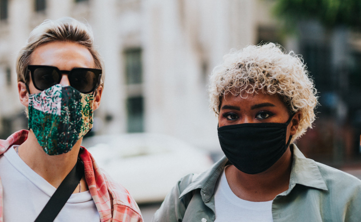 Two people in face masks. Photo by Nathan Dumlao on Unsplash