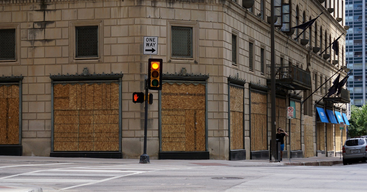 Boarded up storefront. Image by RJA1988 from Pixabay.