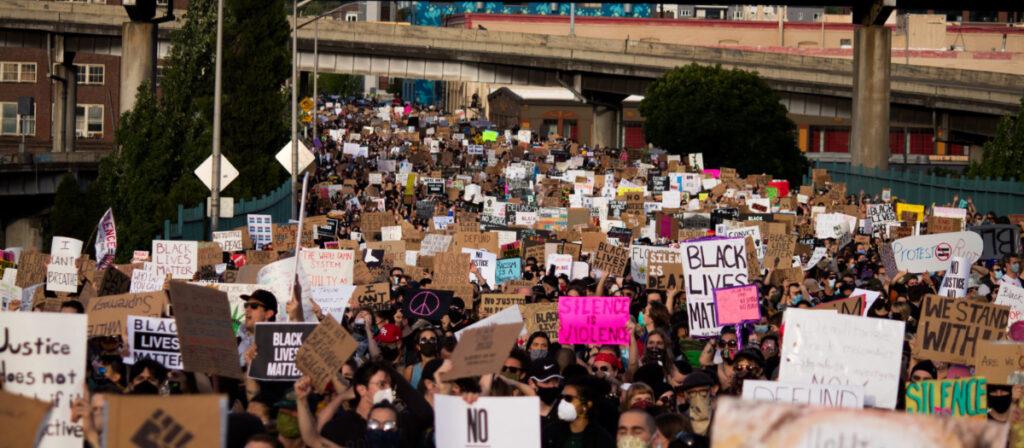 Protesters shut down a bridge in Portland.  Photo by Toto Texidor on Unsplash.