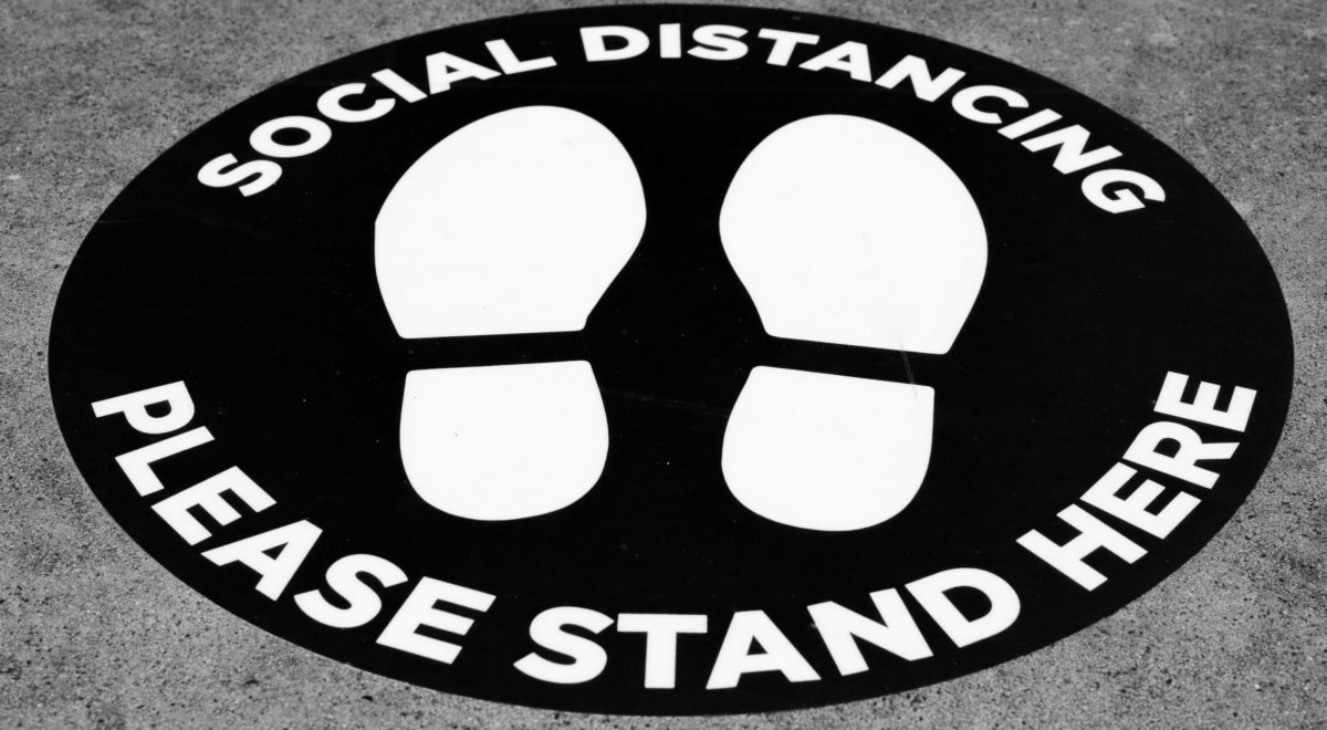 Social Distancing sticker telling people where to stand. Photo by Michael Marais on Unsplash