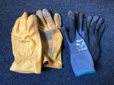 two pairs of work gloves