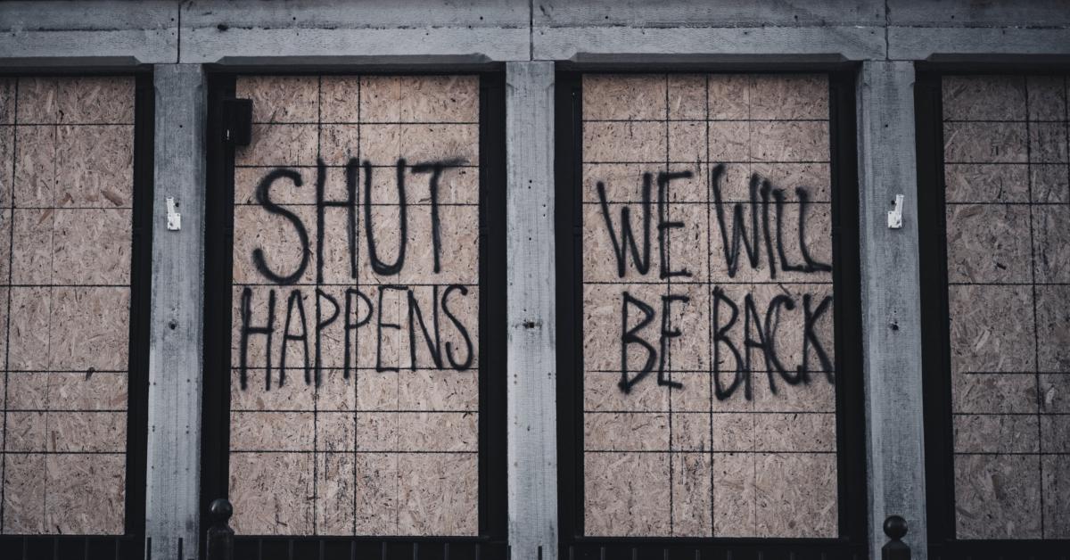 Boarded up store in lockdown mode. Photo by Jason Mowry on Unsplash.