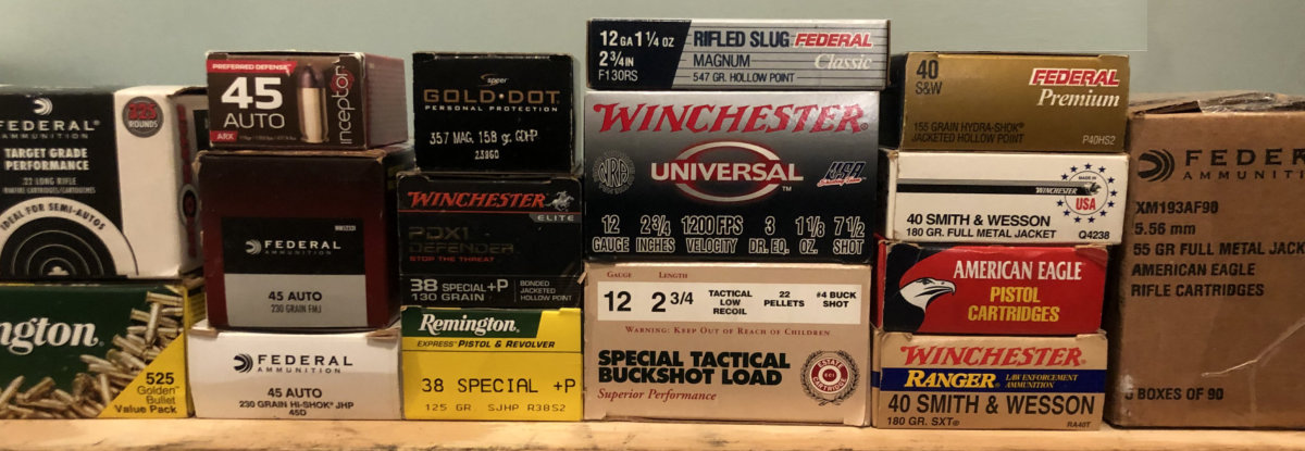 Stacks of different calibers and brands of ammunition
