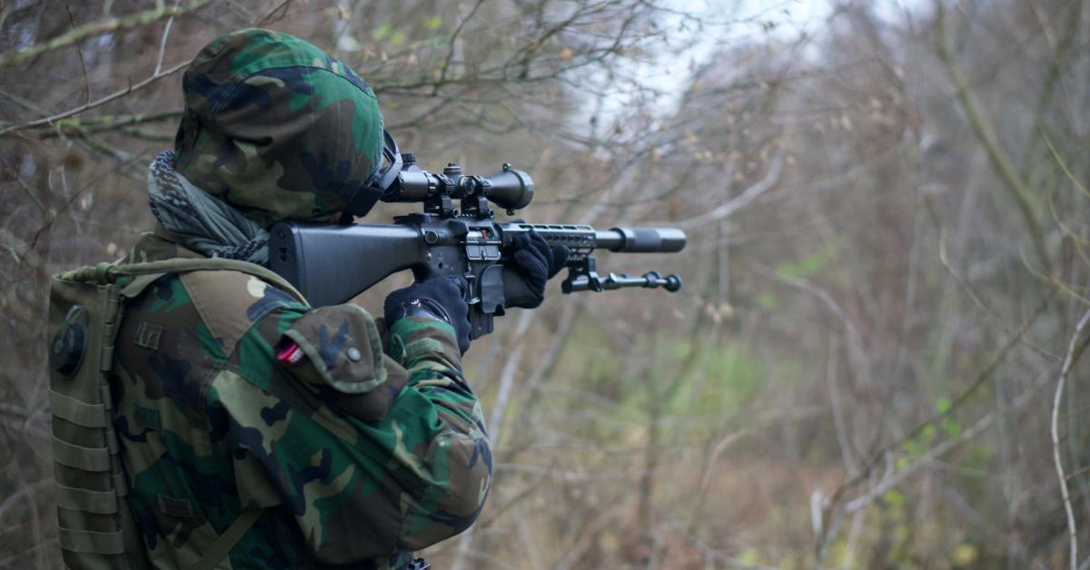 A rifle with a suppressor. Photo by Kony on Unsplash.