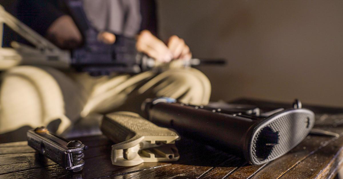 Man inspecting his carbine