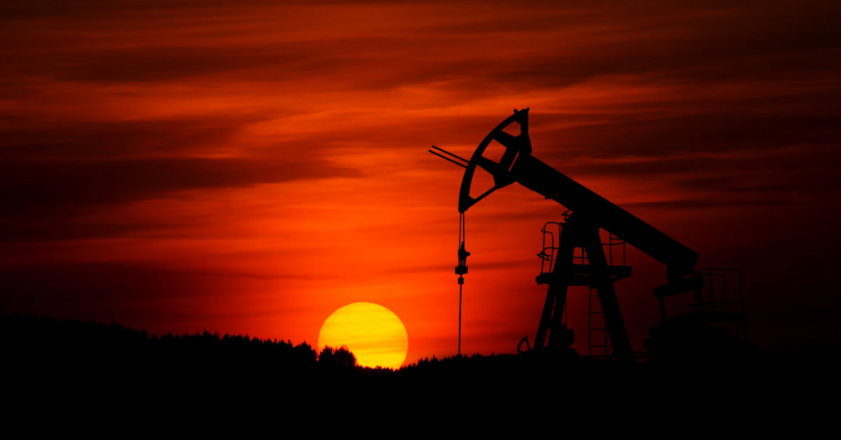 An oil pump at sunset. Photo by Zbynek Burival on Unsplash.