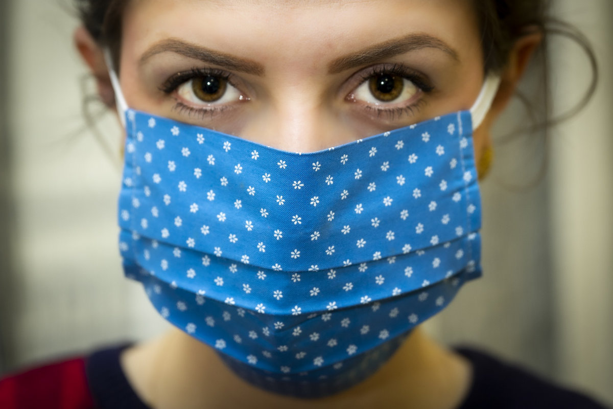 Female wearing a blue cloth mask. Image by Christo Anestev from Pixabay