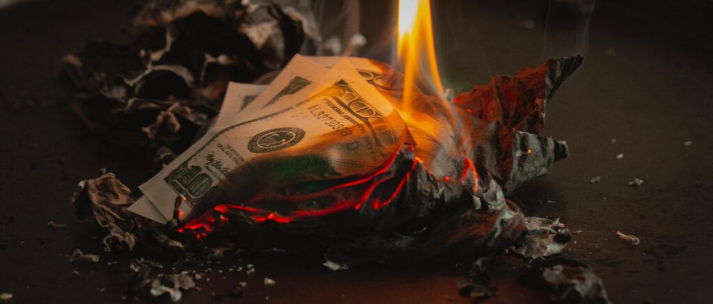 burning cash.  Photo by Jp Valery on Unsplash