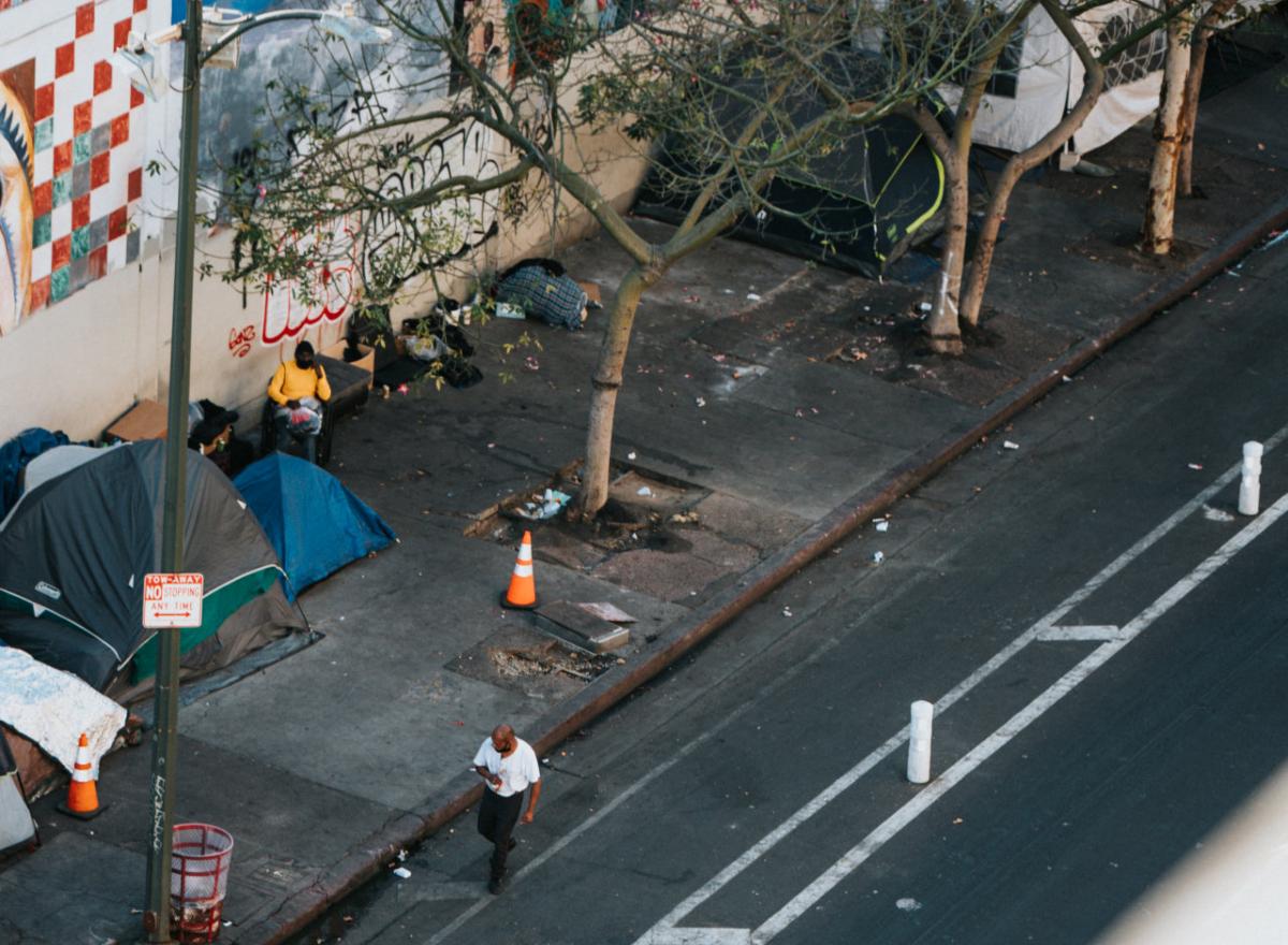 Homeless camp along a city street. Photo by Nathan Dumlao on Unsplash.