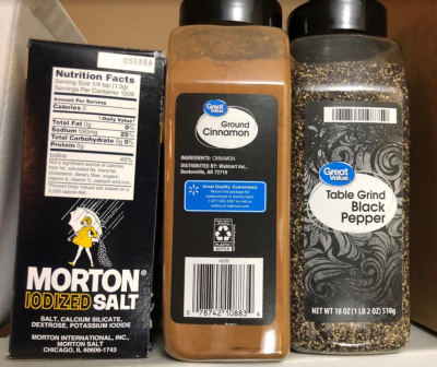 Large bottles of pepper and cinamon