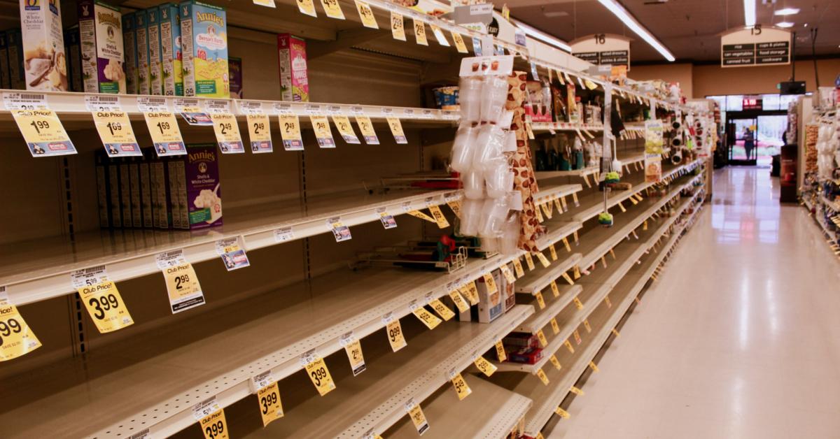 Grocery store shelf picked clean. Photo by Isaiah Villar on Unsplash.