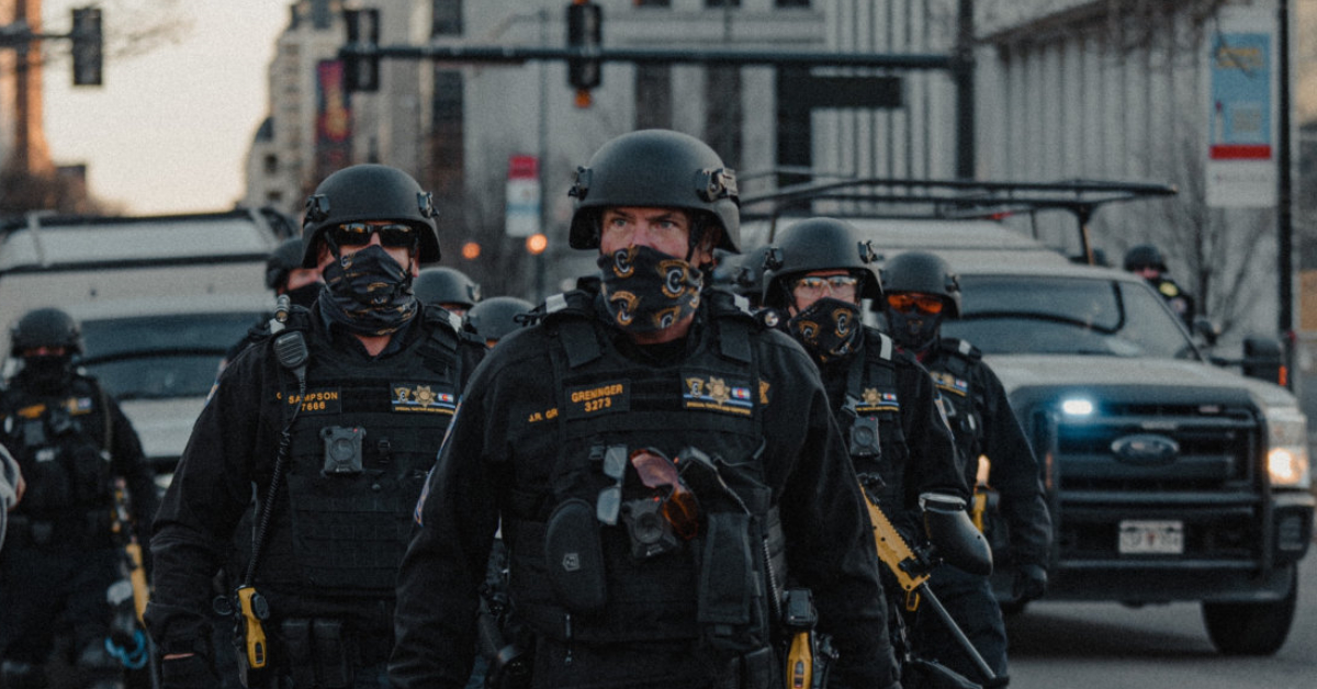 police in combat gear representing force