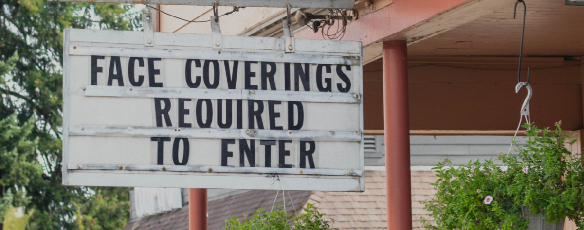 Sign stating face coverings required to enter