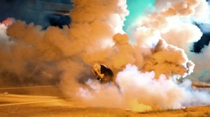 Tear gas being exploded on rioters, looters, and some say peaceful protesters in Ferguson, Missouri.