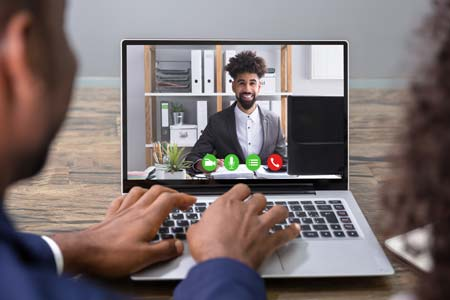 man smiling on video chat