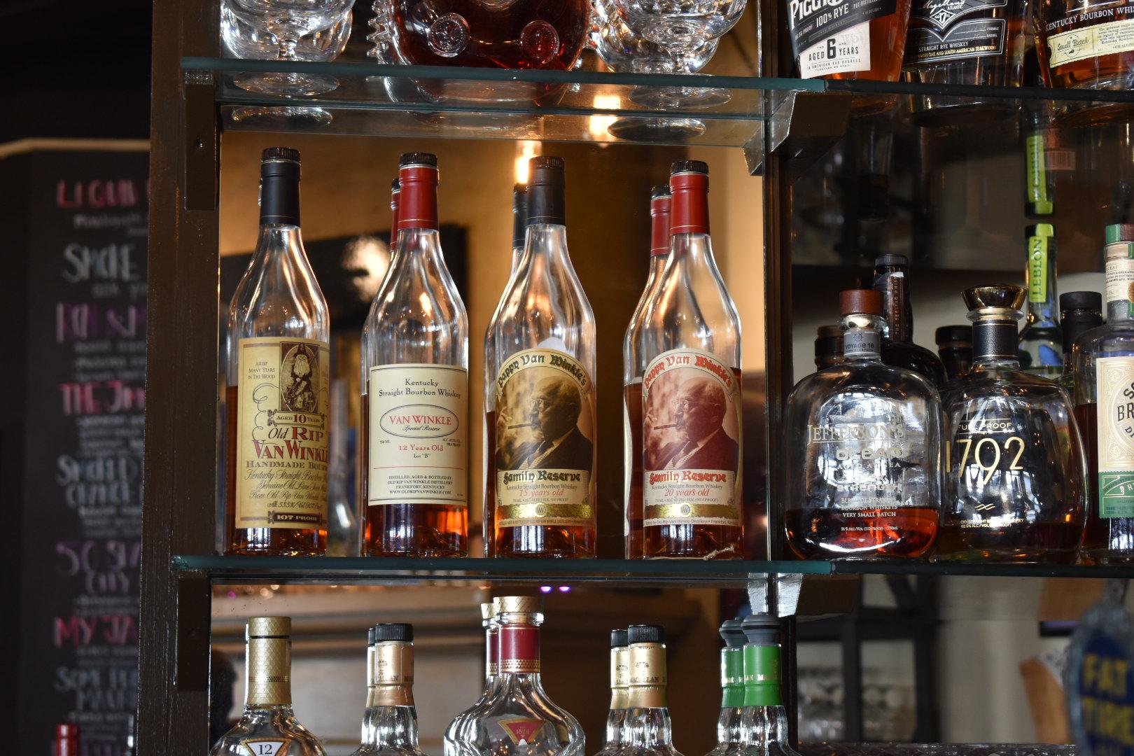 Bottles of Pappy Van Winkle on bar s