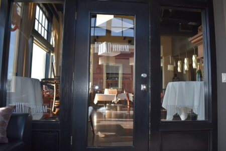 Door and windows with Rhino Room label on them leading into large banquet room