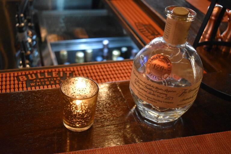 sealed beverage bottle with Artisan 179 single barrel select label on side