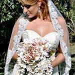 bride wearing a lace border veil