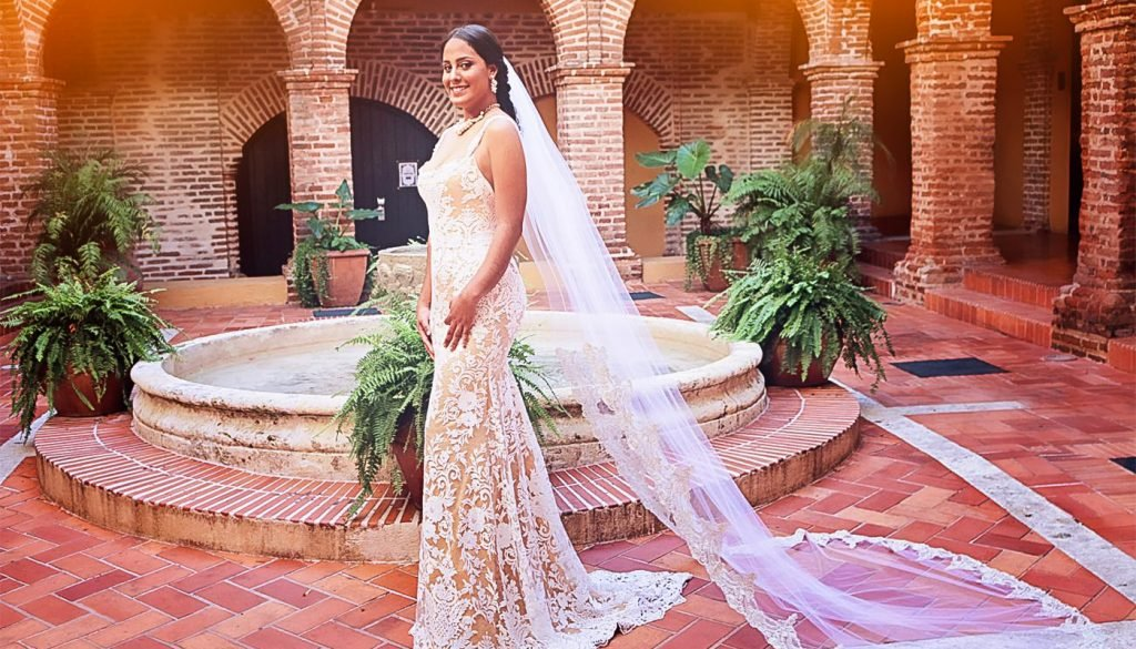 Fisgcut Wedding gown, unique lace gold bridal dress. bride in the court yard