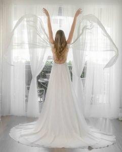 A bride trying on unique wedding dresses near Orlando, FL