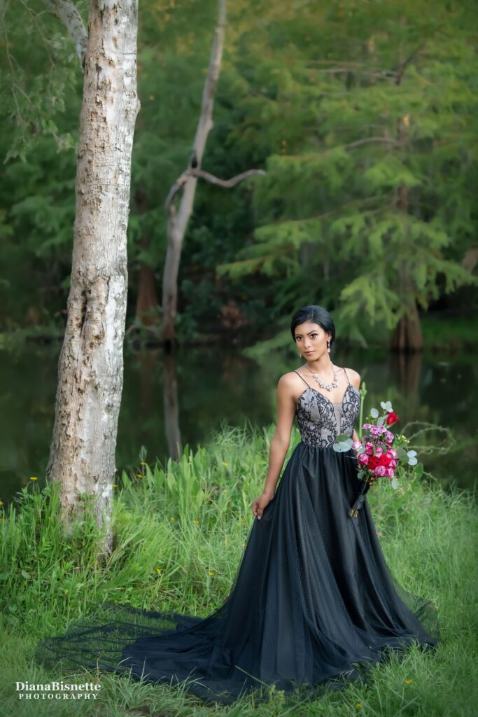 Bride waring a beautiful black wedding dress at the Orlando Botanical Garden