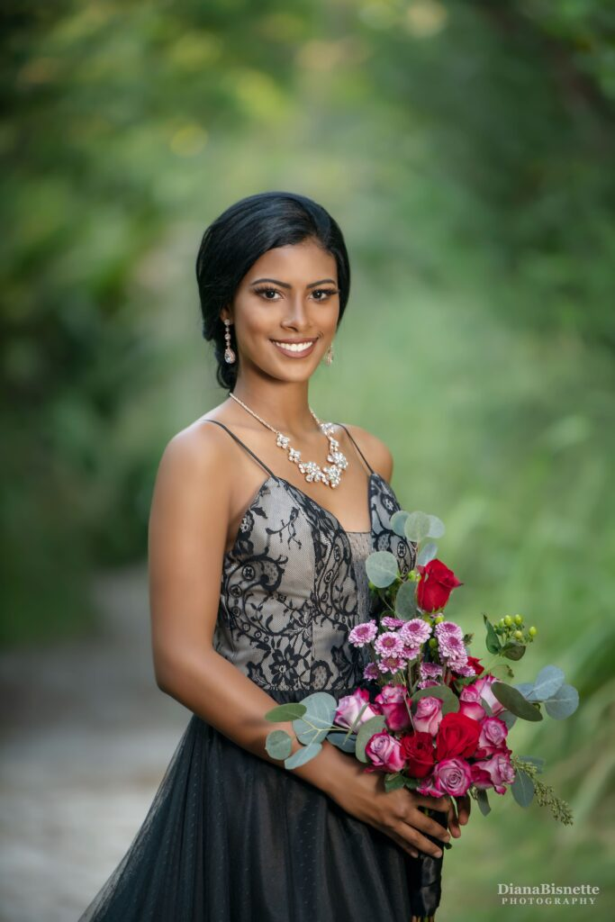 bride standing with a beautiful black wedding dress with a colorful bridal bouquet