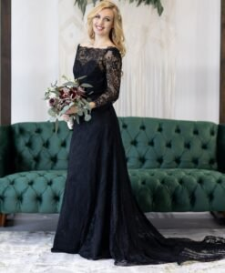bride wearing a black wedding dress, with long lace sleeves, off the shoulder, fit and flare black lace skirt
