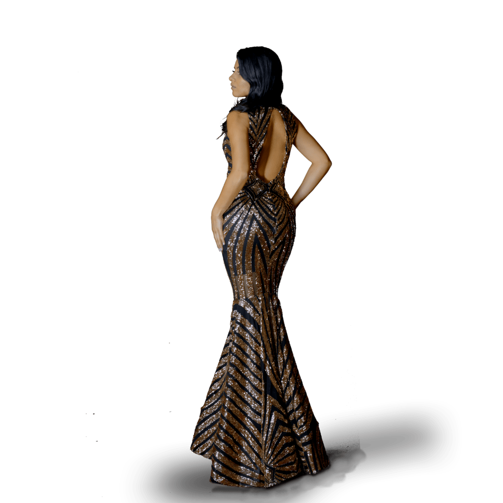 Woman wearing a custom made prom dress, elegant black and rose gold mermaid fitted open back prom elegant floor length with a long full train,