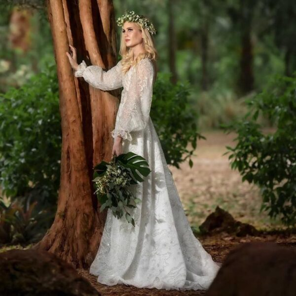 whimsical wedding dress, bride wearing a beautiful beaded gown in the garden near a tree in winter park florida