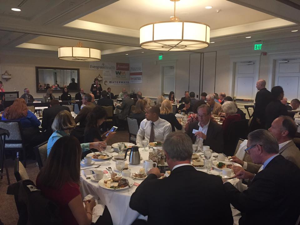 Image of sponsors and diners at Woodmark Hotel luncheon