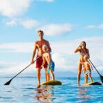 a family paddleboarding and kayaking in Marathon Florida