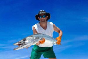 Man wearing holding barracuda caught in the Florida Keys