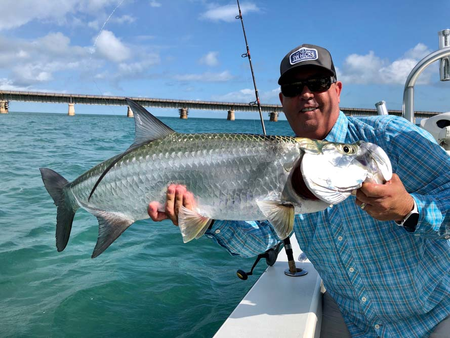 Man holding a large fish caught in the Florida Keys