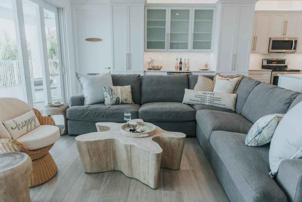 Cozy L-sectional with lots of throw pillows and coffee table in vacation rental in Marathon Florida