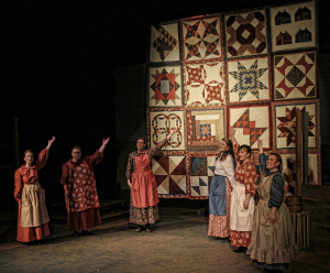 Quilters play