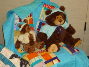 CCQ donated quilts to Camp Erin
