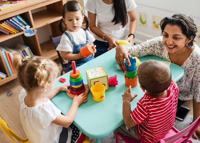 volunteer playing with young children