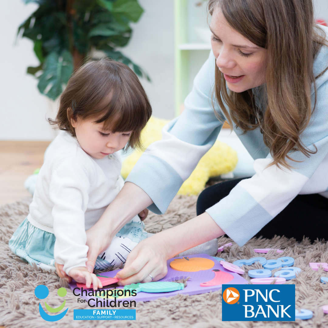 mom playing with daughter, pnc logo with champions for children logo