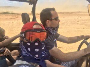 Couple wearing bandanas on UTV tour in Aruba