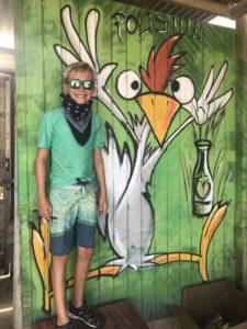 Boy with Aruba chicken mural