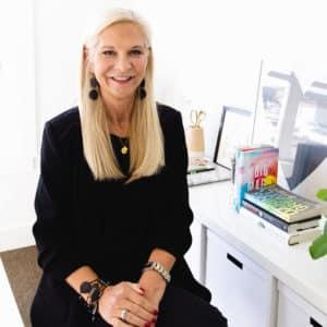 Kristin Bloomquist sitting at a desk