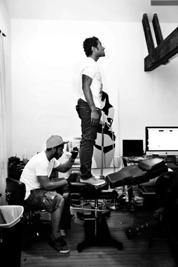 Ryan Henry Tattoo Session with recording artist, Lloyd. (right)