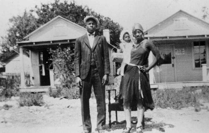 Loil Ellison and Estella Ellison, and daughter Estella Mae Ellison stand in front of their house in East San Antonio in the 1930's